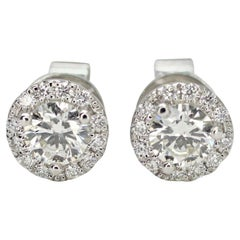 14 Karat White Gold Diamond Halo Stud Earrings .63pts Total Weight
