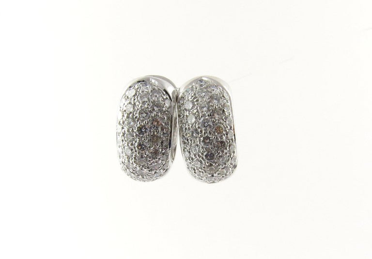 Vintage 14 Karat White Gold Diamond Huggie Earrings-  This sparkling huggie earrings each feature 40 round brilliant cut diamonds set in classic 14K white gold.  Approximate total diamond weight: 2 cts.  Diamond color: G  Diamond clarity: VS2  Size: