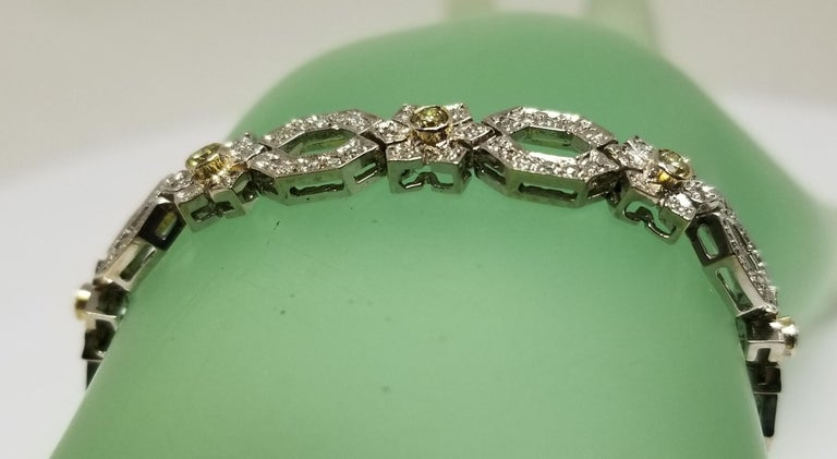 Art Deco 14 Karat White Gold Diamond Link Bracelet with Natural Yellow Diamonds For Sale