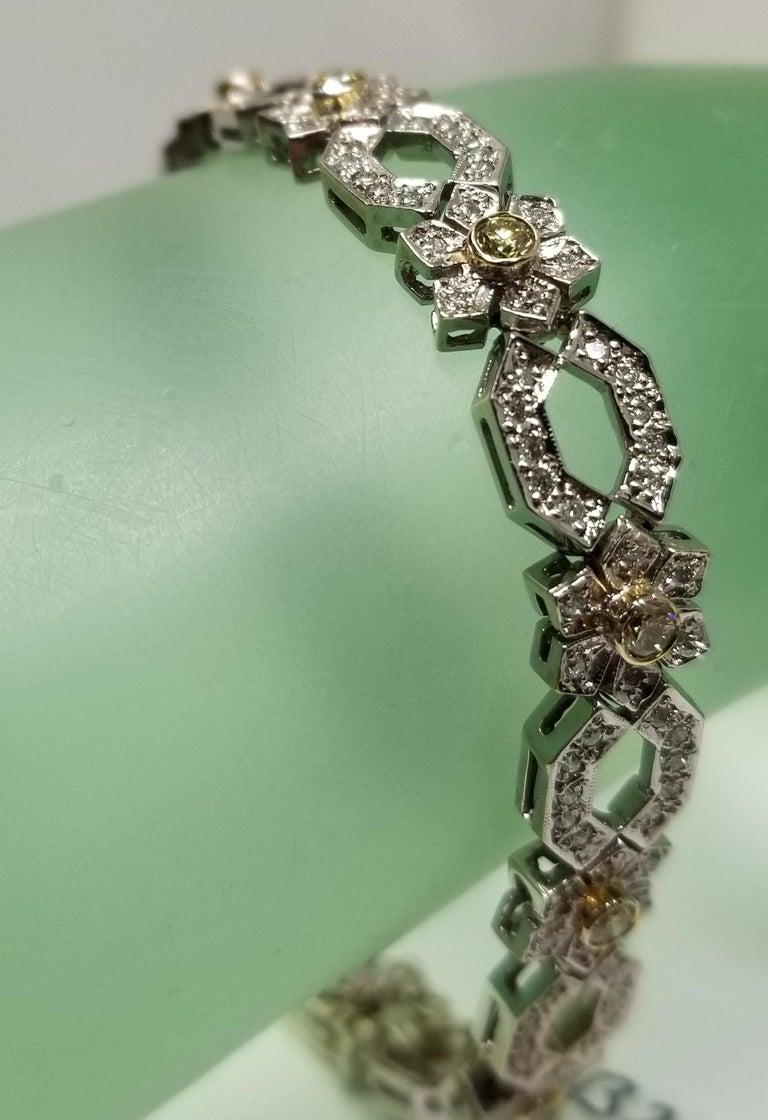 Round Cut 14 Karat White Gold Diamond Link Bracelet with Natural Yellow Diamonds For Sale