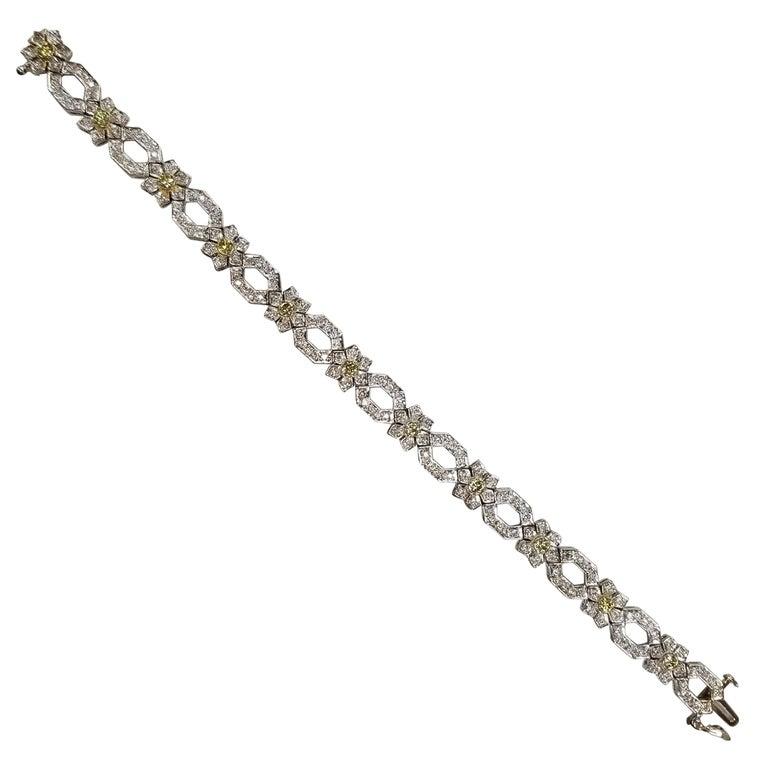 14 Karat White Gold Diamond Link Bracelet with Natural Yellow Diamonds For Sale