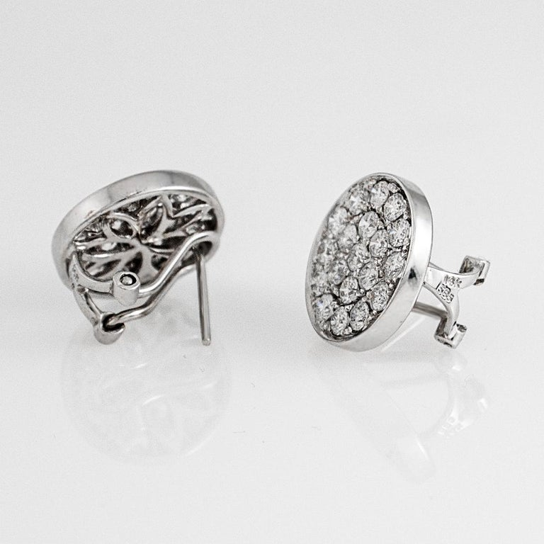 Contemporary 14 Karat White Gold Diamond Pave Round Disc Earrings Omega Back Style Clasps For Sale