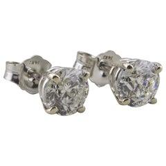 14 Karat White Gold Diamond Solitaire Earrings