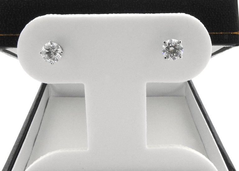 Vintage 14 Karat White Gold Diamond Stud Earrings-  These exquisite earrings each feature one round brilliant cut diamond set in classic 14K white gold. Screw back closures.  Approximate total diamond weight: 1.0 ct.  Diamond color: I-J  Diamond