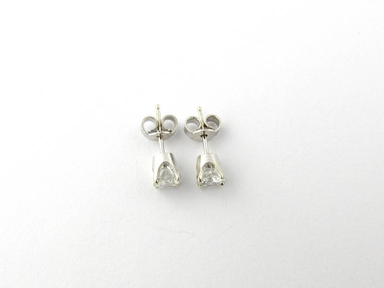 Vintage 14 Karat White Gold Diamond Stud Earrings .84 ct.-  These classic stud earrings each feature one round brilliant cut diamond (.42 ct.) in a four prong white gold setting. Push back closures. Approximate total diamond weight: .84 ct. Diamond