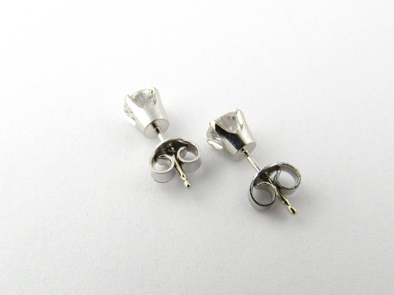 Women's 14 Karat White Gold Diamond Stud Earrings .84 Carat For Sale