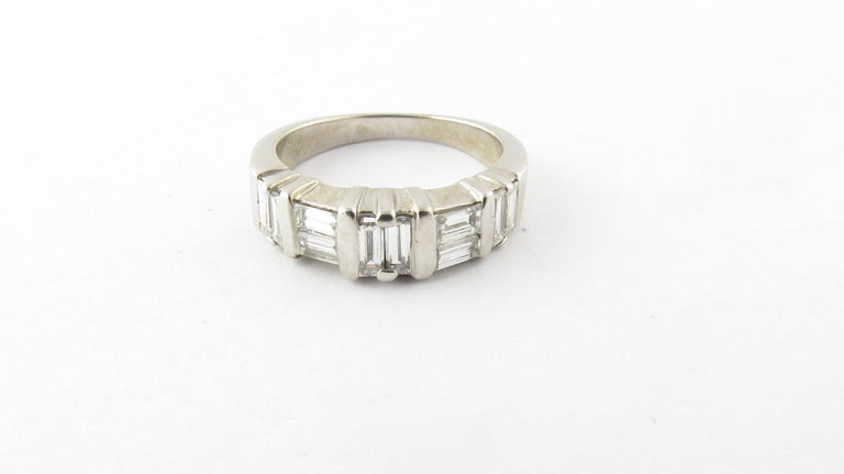 Vintage 14 Karat White Gold Diamond Wedding Band-  This sparkling wedding band is detailed with ten baguette diamonds set in classic 14K white gold. Shank measures 3 mm.  Approximate total diamond weight: .70 ct.  Diamond color: I-J  Diamond