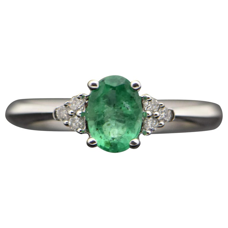 14 Karat White Gold Emerald and Diamond Ring For Sale