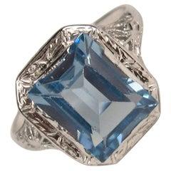 14 Karat White Gold Emerald Cut Blue Topaz Ring Art Deco