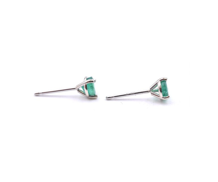 Material: 14k white gold Emeralds: 2 round cut = .46cttw Dimensions: earrings measure 3.9 X 3.9MM Fastenings: post with friction backs Weight: .51 grams