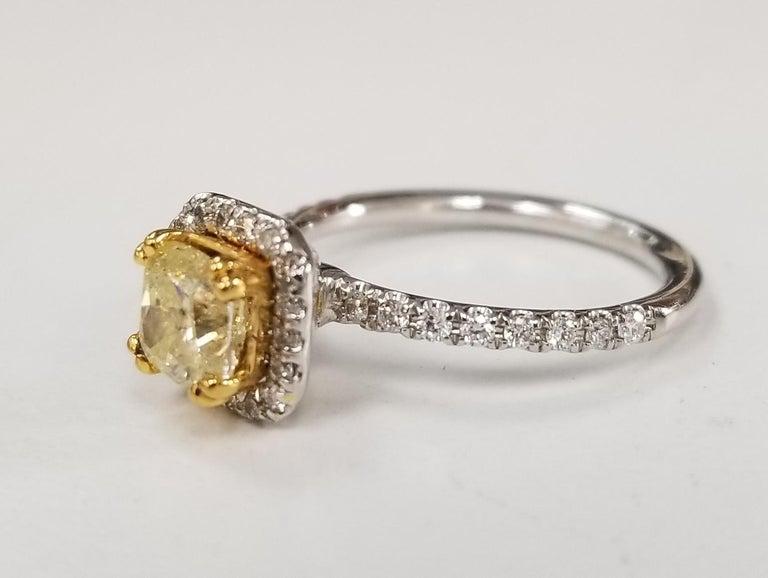 14 Karat White Gold GIA .90pts, Natural Fancy Yellow Diamond Halo Ring;  Specifications:     main stone: GIA .90pts, Natural Fancy Yellow Cushion cut Diamond     additional: DIAMONDS     diamonds: 36 round full cut      carat total weight: 0.38