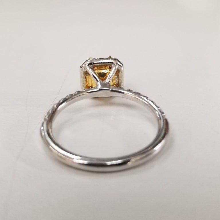 Modern 14 Karat White Gold GIA .90pts, Natural Fancy Yellow Diamond Halo Ring For Sale