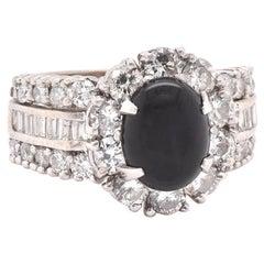 14 Karat White Gold Onyx and Diamond Halo Ring