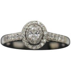 14 Karat White Gold Oval Diamond Halo Ring