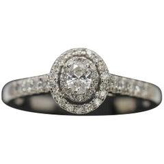 14 Karat White Gold Oval Diamond Halo Ring