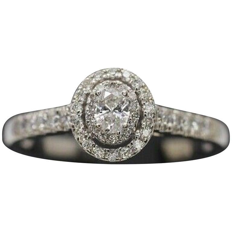 14 Karat White Gold Oval Diamond Halo Ring For Sale