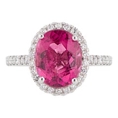 14 Karat White Gold Oval Pink Tourmaline Diamond Halo Ring