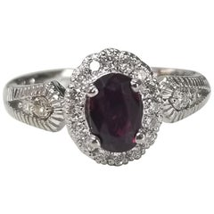14 Karat White Gold Oval Ruby and Diamond Halo Ring