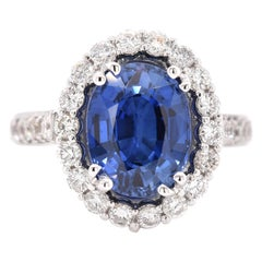 14 Karat White Gold Oval Sapphire and Diamond Halo Ring