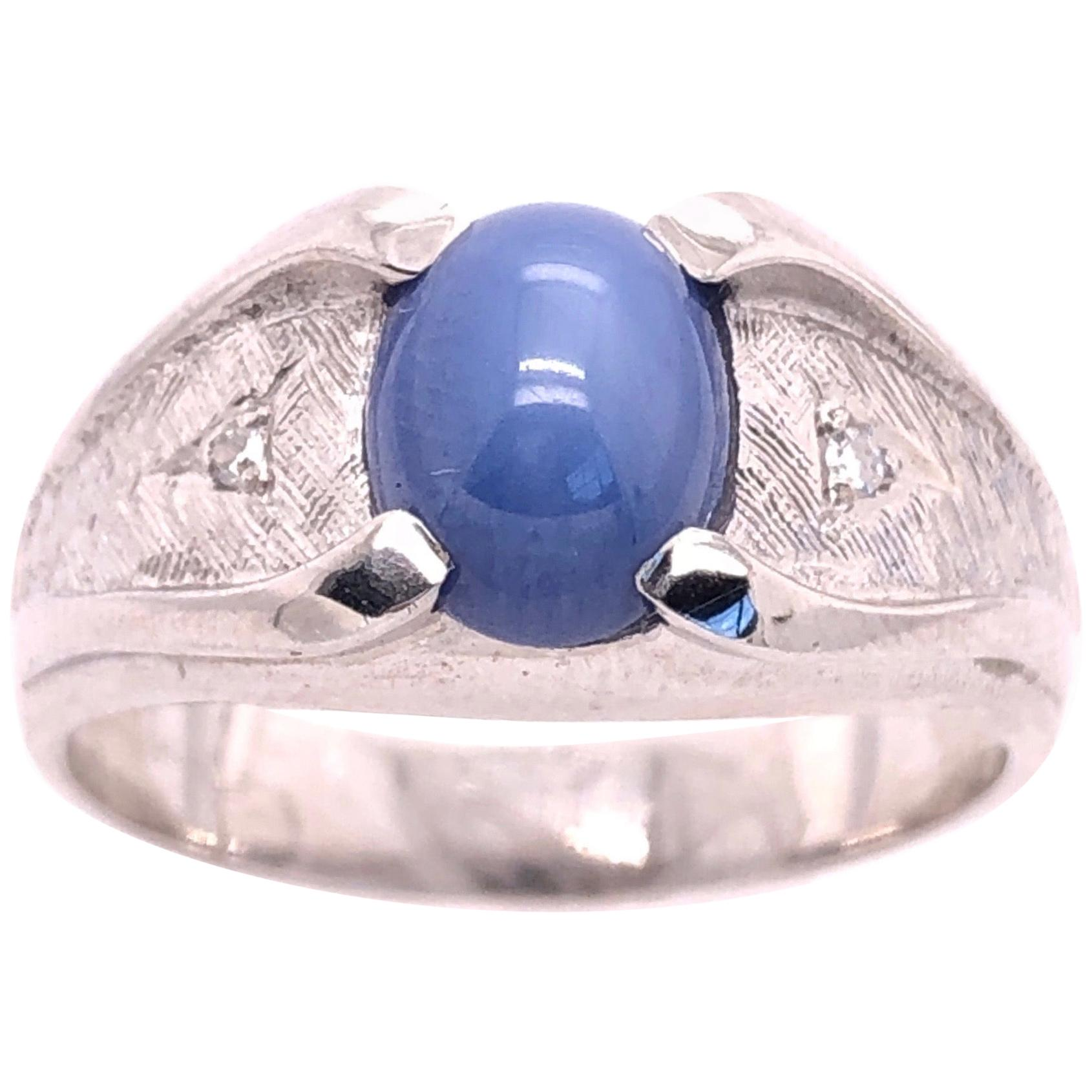 14 Karat White Gold Oval Sapphire Cabochon Ring with Diamond Accents