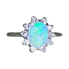 14 Karat White Gold Oval Shaped Australian Opal Ring with Diamond Halo