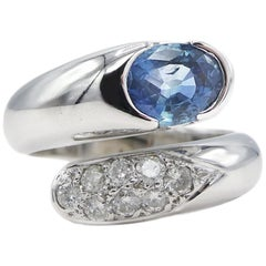 14 Karat White Gold Pave Diamond and Oval Blue Sapphire Bypass Cocktail Ring