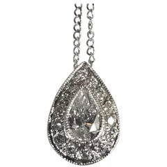 14 Karat White Gold Pear Shape Diamond Pendant with Halo Setting