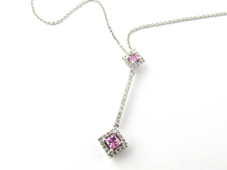 Vintage 14 Karat White Gold Pink Topaz and Diamond Pendant Necklace-  This sparkling pendant features two genuine square pink topaz stones (3 mm and 4 mm) and 41 round brilliant cut diamonds set in a stunning drop design. Hangs from 17 inch white