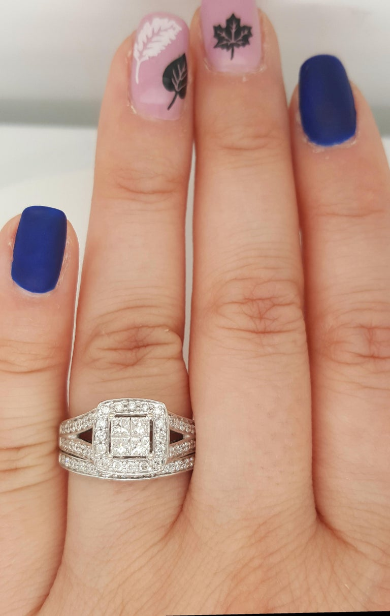 14 Karat White Gold Princess Cut Diamond Cluster, Halo Style Engagement Ring & wedding band. This beautifully crafted ring  has the look of a large center diamond which is comprised of four invisibly set princess cut diamonds surrounded by a halo of