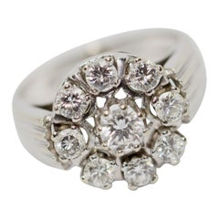 14 Karat White Gold Ring with Solitaire Diamonds
