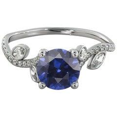 14 Karat White Gold Round Blue Sapphire Flower Style Engagement Ring