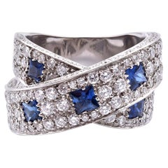 14 Karat White Gold Sapphire and Diamond Crossover Ring