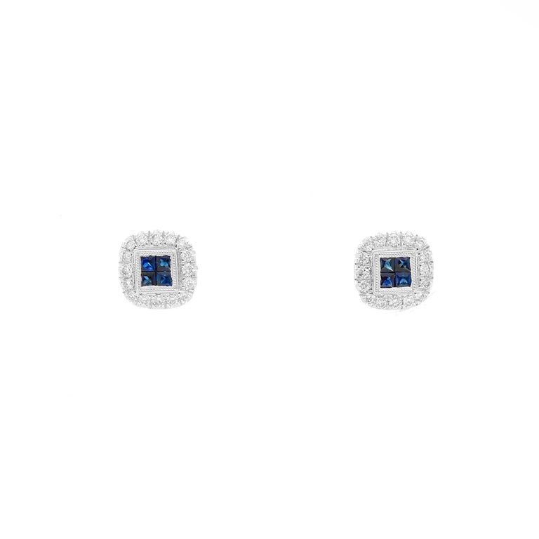 14K White Gold Sapphire and Diamond Earrings  - Beautiful Sapphires weighing .32 cts surrounded by .26 diamonds set in 14K White gold. Total weight 2.4 grams.