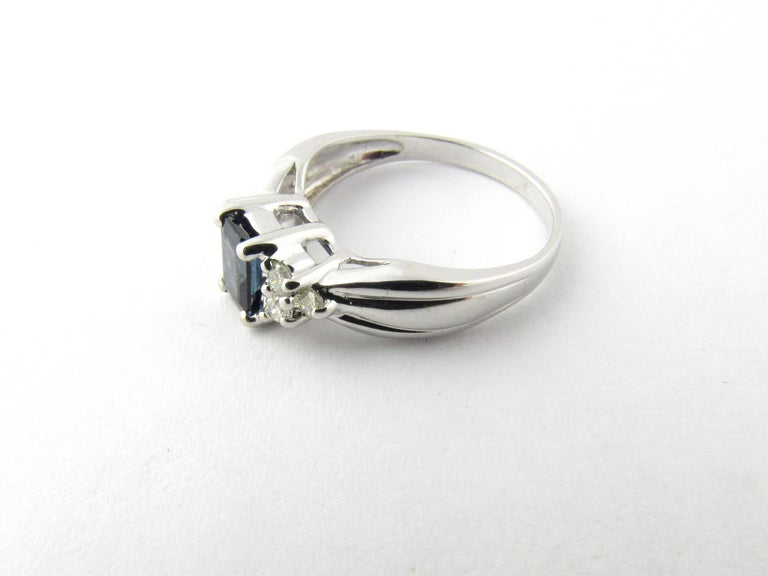 Vintage 14 Karat White Gold Sapphire and Diamond Ring Size 4.75-  This lovely ring features one emerald cut sapphire (6 mm x 4 mm) accented with six round brilliant cut diamonds and set in classic 14K white gold. Shank 2 mm.  Approximate total