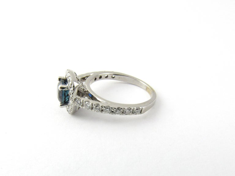 Vintage 14 Karat White Gold Sapphire and Diamond Ring Size 4.75-  This stunning ring features one round sapphire (6 mm) surrounded by 25 round brilliant cut diamonds set in beautifully detailed 14K white gold. Shank measures 2 mm.  Approximate total