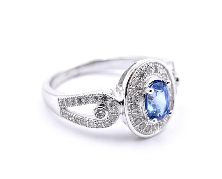Material: 14 karat white gold Gemstones: sapphire = .91ct Ceylon Oval Cut Diamonds: .49cttw Color: F Clarity:  VS2-SI Ring Size: 7.5 (please allow two additional shipping days for sizing requests) Dimensions: ring top measures 12.67mm  X 10.48mm