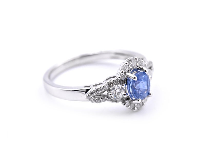 Material: 14k white gold Gemstones: Sapphire = .70ct Oval Certification: AGI 25324 Diamonds: 42 round brilliant cuts = .52cttw Color: F Clarity: VS2-SI Ring Size: 7.5 (please allow two additional shipping days for sizing requests) Dimensions: ring