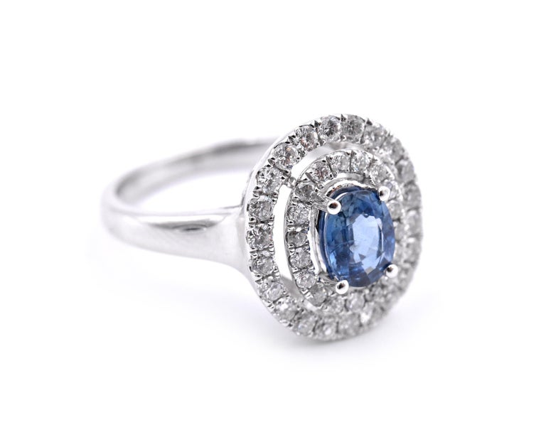 Designer: custom design Material: 14k white gold Gemstones: Sapphire = .78ct OVAL Certification: AGI A1158 Diamonds: 40 round brilliant cuts = .70cttw Color: G Clarity: VS2-SI Ring Size: 7.5 (please allow two additional shipping days for sizing
