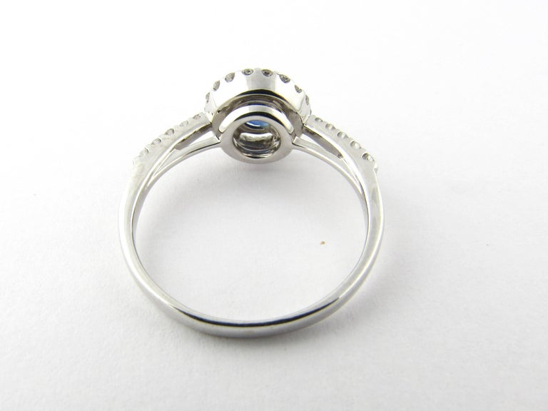 Round Cut 14 Karat White Gold Sapphire and Diamond Ring