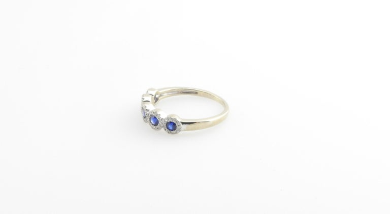 Vintage 14 Karat White Gold Sapphire and Diamond Ring Size 6.25  This lovely ring features five round sapphires and 59 round brilliant cut diamonds set in classic 14K white gold. Width: 5 mm. Shank: 1 mm.  Approximate total diamond weight: .30