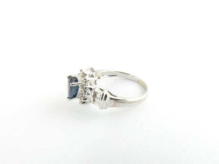 Vintage 14 Karat White Gold Sapphire and Diamond Ring Size 6.5  This lovely ring features one pear shaped sapphire (8 mm x 6 mm), 12 round brilliant cut diamonds and six baguette diamonds set in classic 14K white gold. Shank: 2 mm.  Approximate