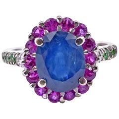 14 Karat White Gold Sapphire, Ruby, and Tsavorite Halo Ring
