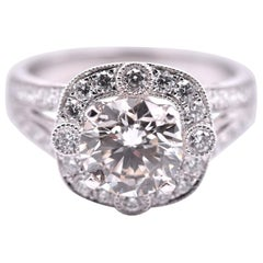 14 Karat White Gold Split Shank Round Diamond Halo Engagement