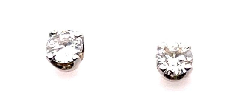 14 Karat White Gold Stud Diamond Earrings. 0.50 total diamond weight 0.76 grams total weight.