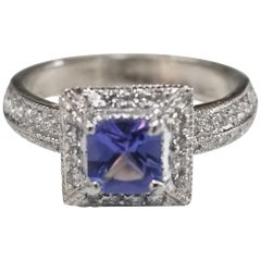 14 Karat White Gold Tanzanite and Diamond Ring with Halo