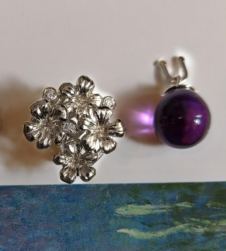14 Karat white gold Plum Blossom modern brooch with removable amethyst drop is encrusted with the 3 round diamonds (0.1 Carat). This contemporary jewellery collection has been featured in Vogue UA reviews. The cabochon lemon quartz can be exchanged