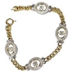 """14 Karat Yellow and White Diamond Bracelet with """"Dancing"""" Diamonds in the Middle"""