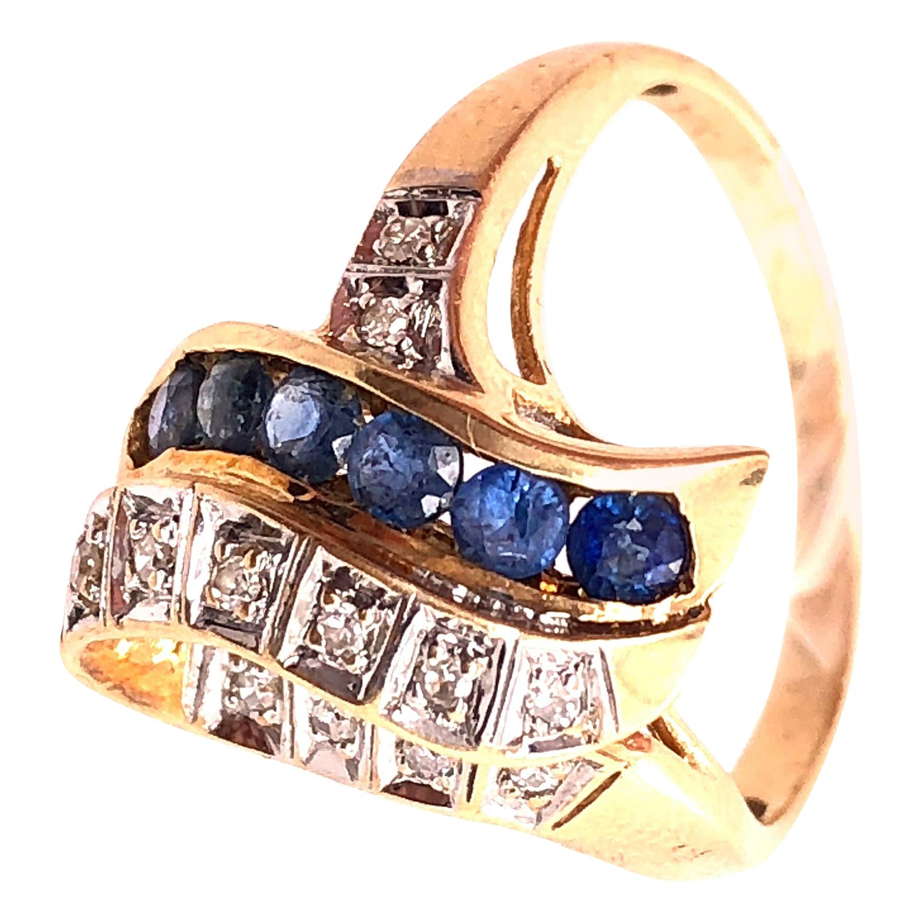 14 Karat Yellow and White Gold Blue Sapphire and Diamond Contemporary Ring