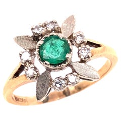 14 Karat Yellow and white Gold Emerald Solitaire with Diamond Accents Ring