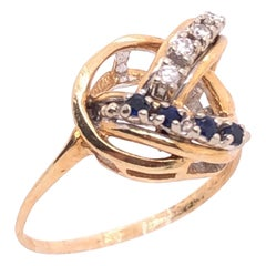14 Karat Yellow and White Gold Freeform Ring with Sapphires and Diamonds